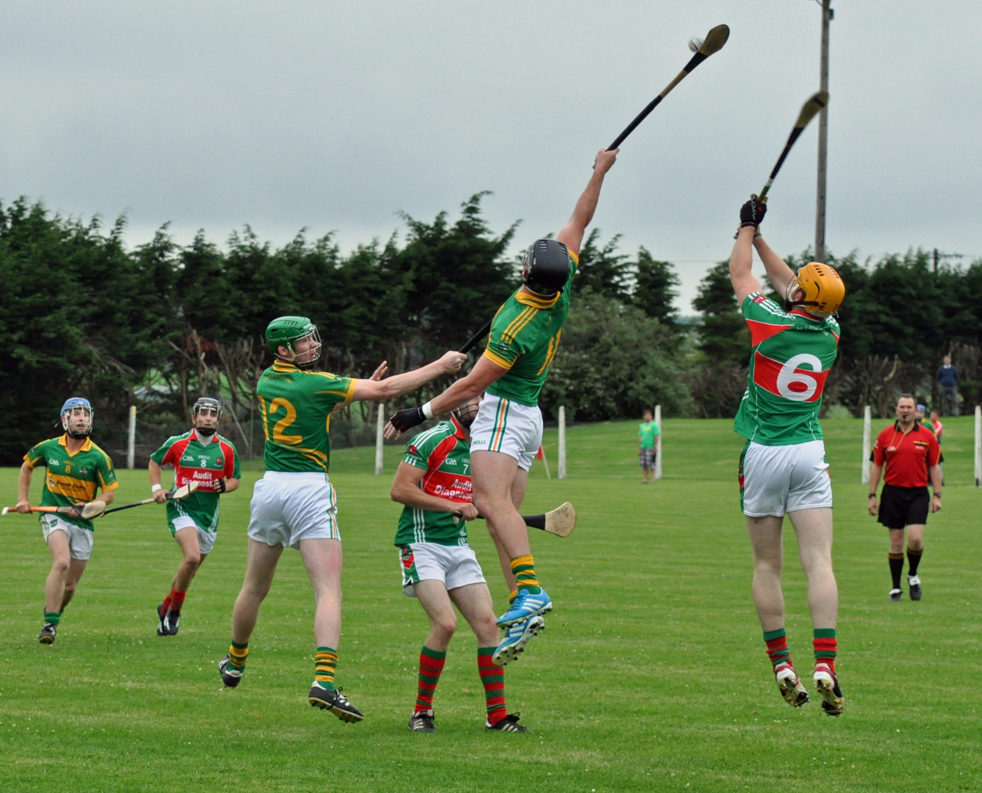 Colm Spillane goes high to tap down to Shane Moroney in our U21 game V Fr O Neills