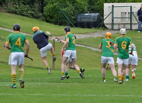 Eoin Barry gets in a might clearance in the JBHC v Dungourney