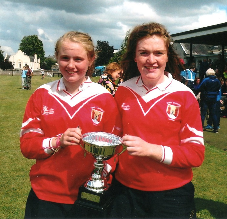 Cork Camogie U14 Star Gráinne McCarthy on the right with the Cup after winning the Kilkenny Blitz.  On left is Emer Hurley of the St Finbarrs Club.