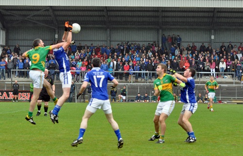 No 9 Barry Fitzgerald goes high to tap down to Ronan Fenton
