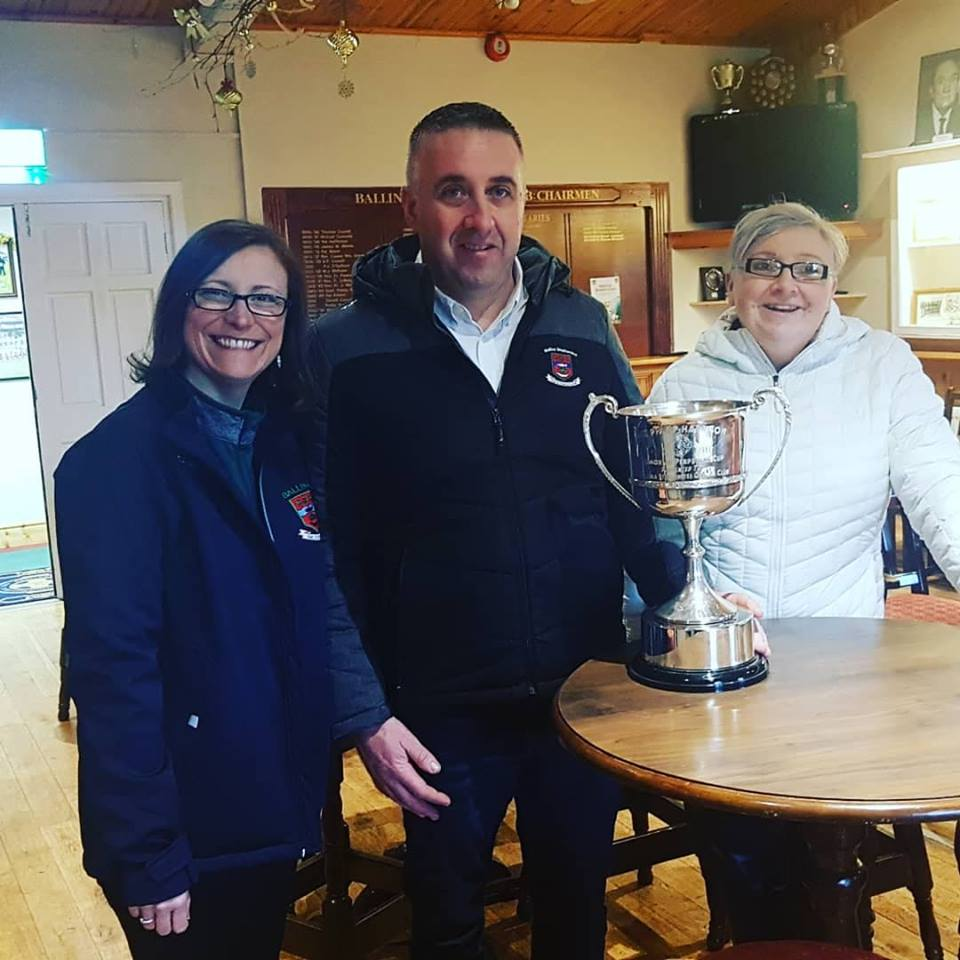 Mags Downey Martin Club Secretary, Tony Neary Club Chairman and Majella Varley Club Treasurer, with the Philip Harrison Cup