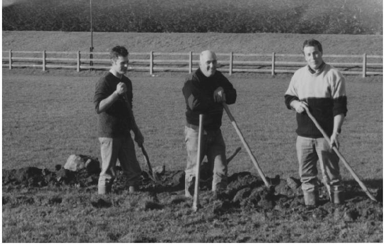 Resting their shovels from digging shores are Pat Doolan, J.J. Guinan and John Moran