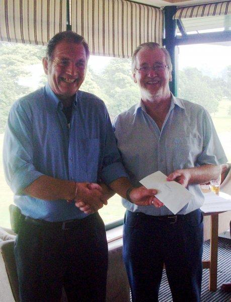Overall Winner Aidan Buckley receiving his prize from Captain Brendan Hawkins