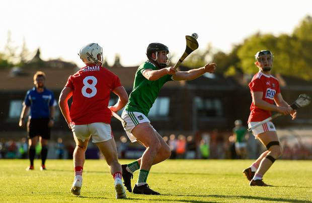 Ronan Connolly of Limerick blocks a pass by Tommy O'Donnell of Cork during the Bord Gáis Energy Munster Under 20 Hurling Championship quarter-final at Páirc Uí Rinn in Cork. Photo: Eóin Noonan/Sportsfile