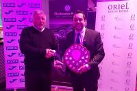 Ger Lynch CSL presents Chis Sheehan with his CSL Referee of the Year trophy