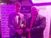 Peter Connolly Chairman CSL presents Oran Daly (Greenwood) with his CSL Overall Player of the Year trophy