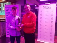 Ivan Bevan Cork U14 coach presents Oran Crowe (Midleton) with his CSL U14 Player of the Year trophy