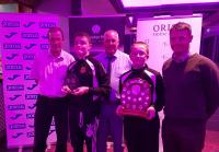 Nick Harrison FAI FFA Officer presents Midleton FC with their CSL/CFFAF Inclusive Club of the Year trophy