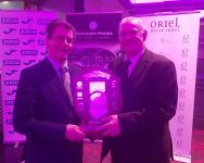 Tony Fitzgerald President FAI presents Donncha Gould (Carrigaline United) with his CSL Administrator of the Year trophy