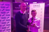 Niall Cotter of Blackwater Motors presents Joe O'Brien-Whitmarsh (Fermoy) with his CSL U12 Player of the Year trophy