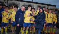 Paul Gallagher of Skechers presents the SFAI Skechers U16 Regional Cup to Douglas Hall