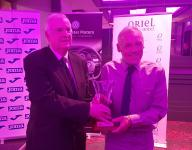 Tony Fitzgerald President FAI presents Gerry Hurley with his CSL Hall of Fame trophy
