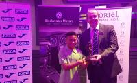 Ronan Fahy of Oriel House Hotel presents Leon Ayinde (Leeds) with his CSL U13 Player of the Year trophy