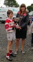 Adrigole U12 Captain receiving John L Memorial Trophy