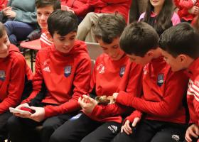 Ben taking care of Seanie's Golden Boot