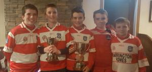 Under 16s younger players showing the cups 2016