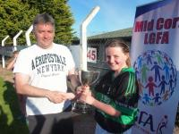 Ken presents the cup to Fe12 Captain Aisling Flanagan