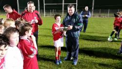 Conor Twomey Captain Kilara Og U10 Football Team Receiving Cup From Alan Hegarty