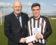 Midleton AFC-Michael Foley MSL presenting Beamish Stout man of the match award to James McCarthy-Midleton AFC v Fermoy AFC