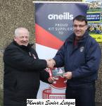Leslie Doyle presenting the O'Neills club of the week voucher to Garret Lyons Douglas Hall
