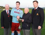 Henry O' Herlihy presents the John Hayes Trophy to Youghal Utd Capt Lee Desmond accompanied by Tony Murphy and John Finnegan MSL