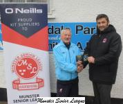 John Finnigan presenting ONeill Club of the week voucher to Chris Herlihy Avondale utd