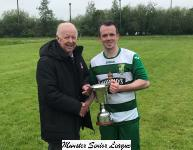 Tony Murphy President Munster Senior League presenting the Senior 2nd Div League Trophy to Park Utd Captain William O Brien