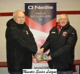 Michael Foley presenting the O'Neills club of week voucher to Pat Cummins Castleview