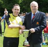 Michael Foley presents the Sen 2nd Div League trophy to Riverstown Capt Paul Tierney
