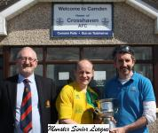 Rob Cogan of Cogans Toyoto Carrigaline presents the O'Connell Cup to Rockmount Captain Ken Howey with Pat Quinn MSL in attendanc
