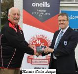 Sean O Sullivan presents the O'Neills club of the week voucher to David Madden Avondale Utd