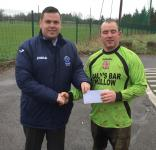 Mallow Utd-Barry Cotter MSL presenting Beamish Stout man of the match award to Stephen Healy -Mallow Utd v Leeside
