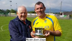 Leslie Doyle Hon Registrar MSL presents the Beamish Stout Junior 2nd Division Trophy to Greg O'Halloran  Captain Carrigaline Utd