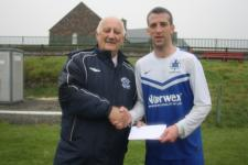 Kinsale-Sean O'Sullivan MSL presenting Beamish Stout man of the match award to Sean Lyons Kinsale -Kinsale V Riverstown