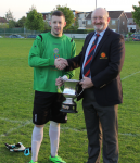 Nick McCarthy Capt Douglas Hall receives the Junior Premier League Trophy from Pat Quinn MSL