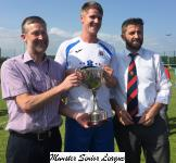 Ray O'Mahony,Red Cove Inn,presents the John Hayes Cup to Leeds capt Dan O'Callaghan with M S L Chairman John Finnegan