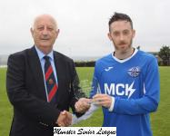 Crosshaven v Wilton Utd '17-'18-Sean O'Sullivan presents the man of match award to Owen Lawyer Crosshaven