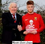 UCC v Everton - Peadar O'Leary MSL presenting the man of match award to Owen Collins UCC