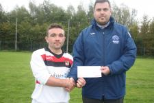 Casement Clt-Patrick Duggan, Leeside AFC receives the man of the match award from Barry Cotter MSL,Casement Celtic v Leeside