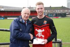 UCC V College Corinthians-Shane Daly-Butz, UCC,  receives the Man of the  Match award  from Pat Lyons MSL