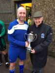 Tony Murphy MSL presenting floodlit League championship Trophy to Alan Larkin captain Leeds.