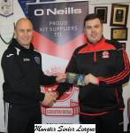 Barry Cotter presents the O'Neills club of the week voucher to John Murphy St Marys