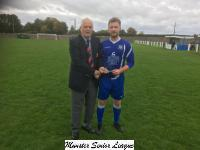Fermoy v Bandon-Michael Foley MSL presents the Beamish Stout Man of the Match award to Fermoy's Kevin Dolan