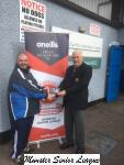 Michael Foley presenting the O'Neills Club of the week voucher to Fermoy P R O Emmett Hull