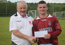 Leslie Doyle MSL presenting the Beamish stout man of the match award to Dean Donoghue Youghal Utd Casement Celtic V Youghal Utd