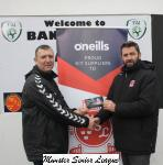 John Finnigan presenting the O'Neills club of the week voucher to Jim Mccarthy Bandon