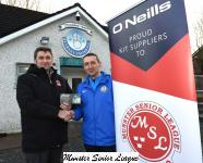 John Finegan Presents the O'Neill's Club of the week voucher to Ger Sheehan Blarney Utd