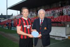 Beamish Senior Cup Final Eric Hagarty, Ringmahon Rgs receives the Man of the Match award from Michael Foley MSL