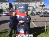 Pat Lyons  presents the O'Neil's club of the week voucher to Michael Hourihan Leeds