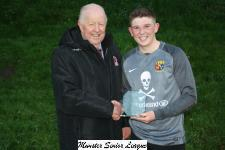 Kilreen v UCC-MSL President Tony Murphy presents the man of the match award to Conor Fitzgerald UCC